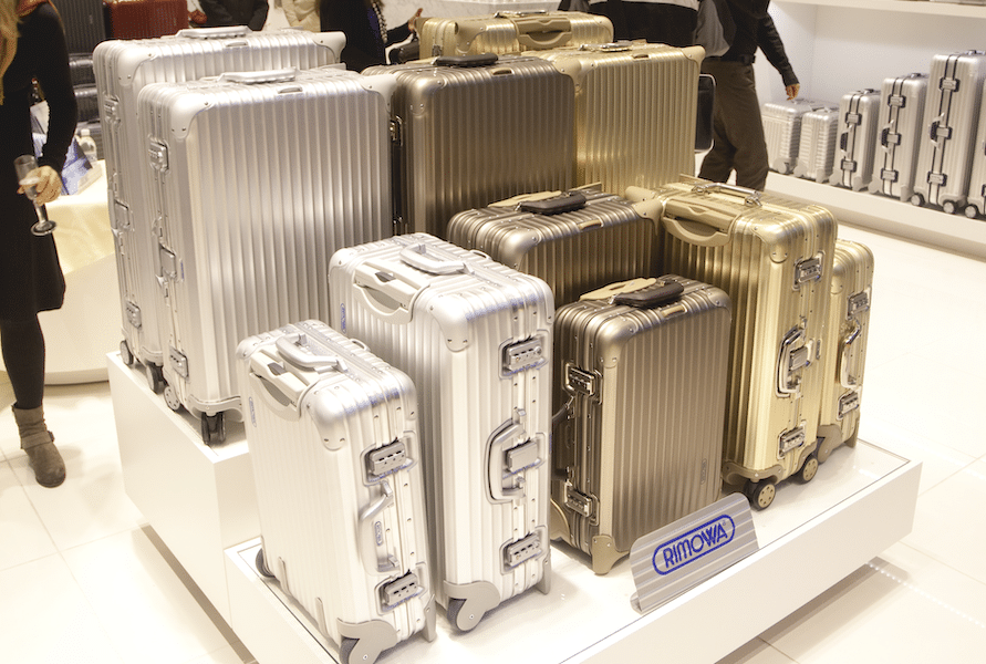 10 Luxury Suitcases being shown on display in store with brand name showing
